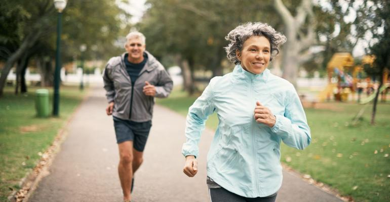 Healthy older woman and man exercising