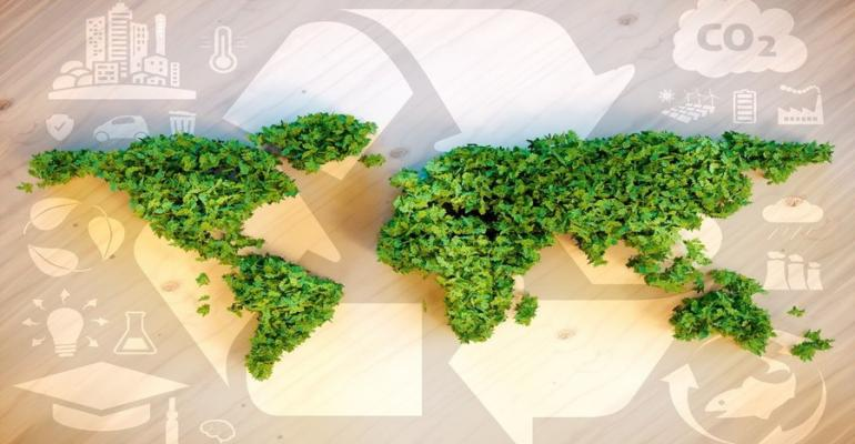 sustainability concept world map of plants on recycling logo