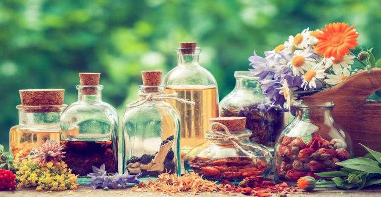 medicinal plants and vials of botanical tinctures